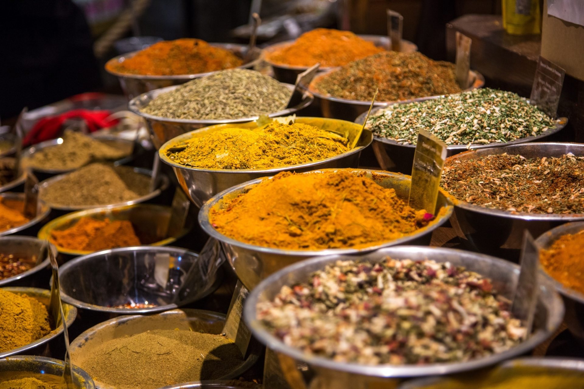 Large bowls with spices on the market